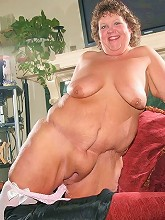 Massive BBW playfully stripping off her clothes live to show off her sexy stockings and huge racks_30