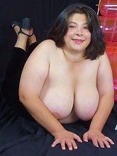 Live clip of a pretty young BBW model taking off her top to play with her huge fat tits_30