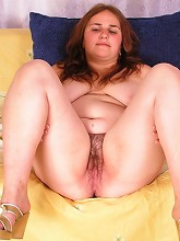Charming fatty plays with her jugs and hairy pussy_30